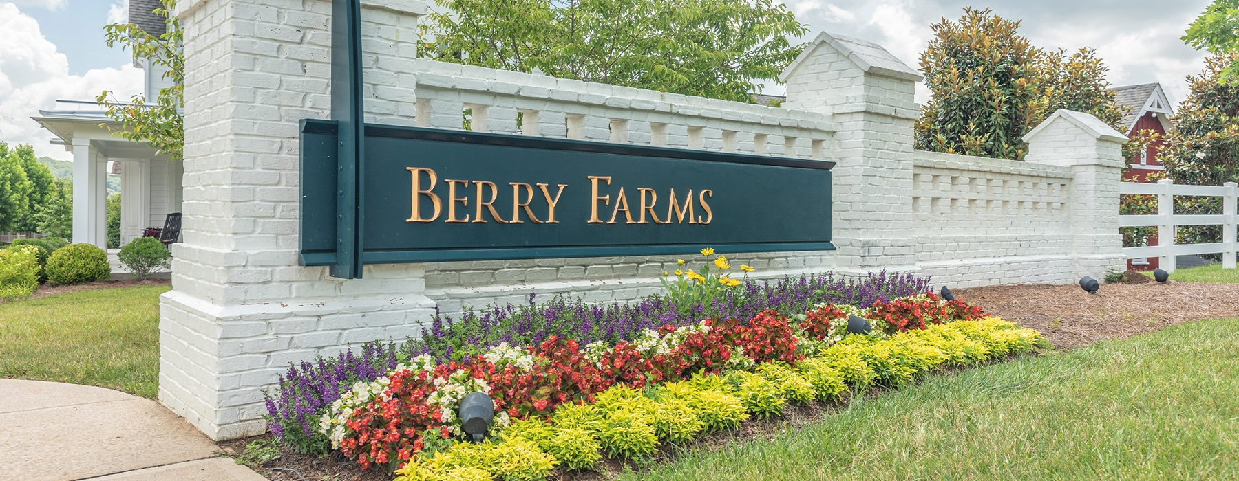 Entrance to Berry Farms beautifully landscaped with flowers,