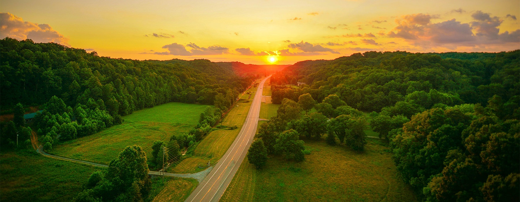 Beautiful sunset at the end of a long country road